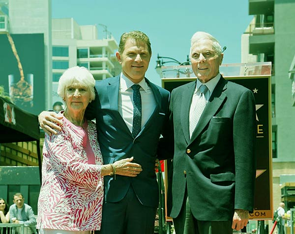 Image of Caption: Bobby with his father Bill and mother Dorothy