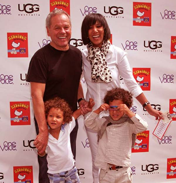 Image of Wolfgang Puck with his wife Gelila along with their sons Oliver and Alexander