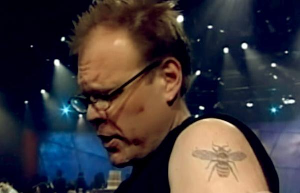 Image of Alton Brown tattoo of Honeybee on his left shoulder