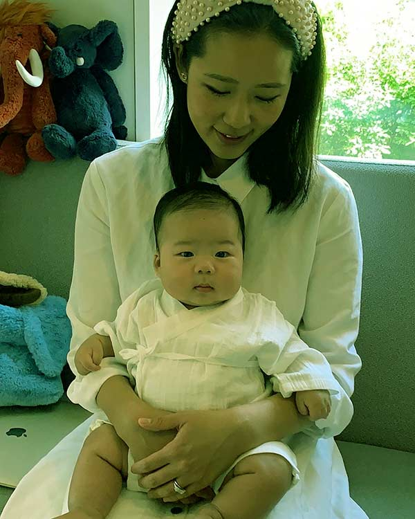 Image of David Chang wife Grace with son Hugo