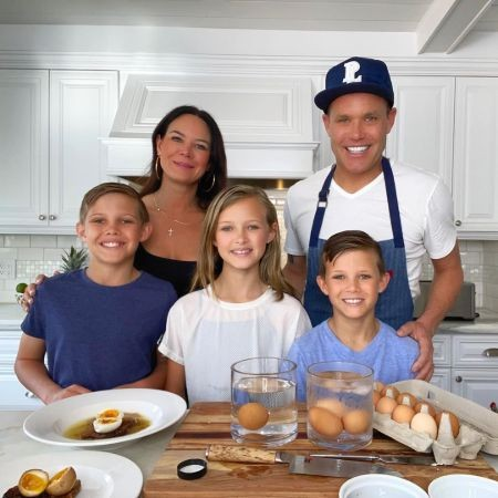 Image of chef and restaurateur, Brian Malarkey with his wife and kids