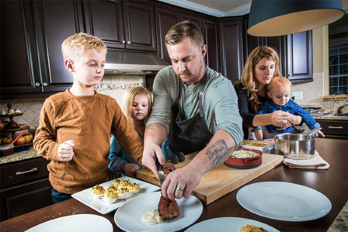 Image of renowned chef, Bryan Voltaggio with his family