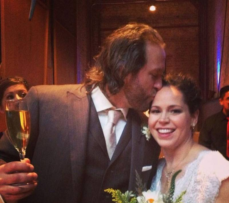 Stephanie Izard and her beloved husband in their wedding
